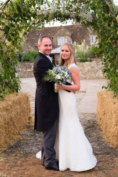 Bride-groom-wedding-flowers-arch