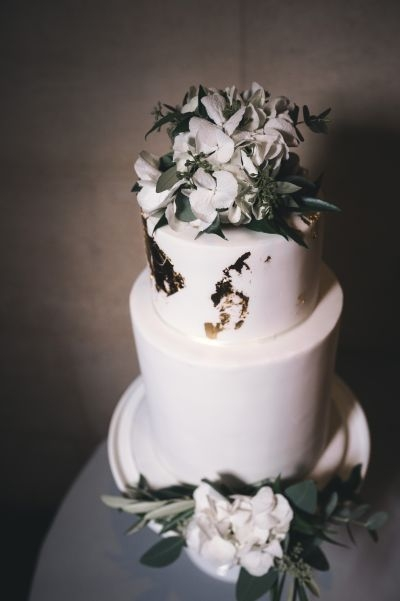 Wedding cake with white gold hydrangea foliage