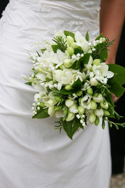 Bride's classical bouquet - white roses, lily of the valley, freesia