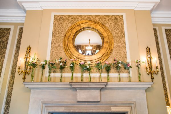 Mantelpiece wedding flowers - Courtney Louise image
