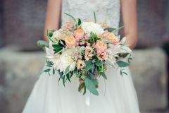 Bridal bouquet with apricot roses, dahlia, foliage