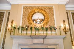 Mantelpiece wedding flowers - Courtney Louise image credit