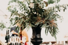 Table decorations: foliage vase and candles
