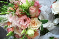 Bride's bouquet - pink and apricot roses, astilbe & herbs.