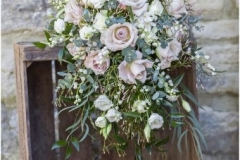 Bride's bouquet - vintage roses, lily of the valley, foliage
